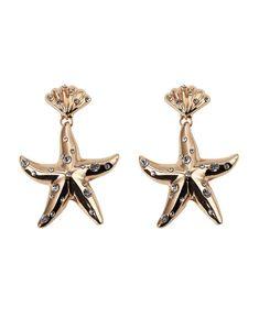 959def8e83cc Pendientes estrella de mar dorados con lunares blancos de Le Collier. Estos pendientes  de fiesta