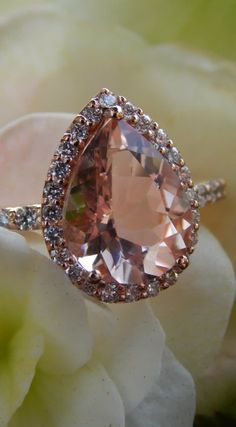 1.50 Carat Pear Cut Morganite and 0.38 Carat Total Weight Diamond Halo Engagement Ring by Barkev's. Available at BenGarelick.com $2670. https://www.bengarelick.com/products/barkevs-14k-rose-gold-pear-cut-morganite-halo-diamond-engagement-ring