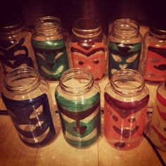 #DIY #tiki lanterns using pasta jars and acrylic paint - looks even better lit up at night :)