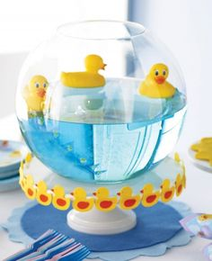 Would be an easy centerpiece - bowl, cake plate, blue colored water and bath toys of your choice!