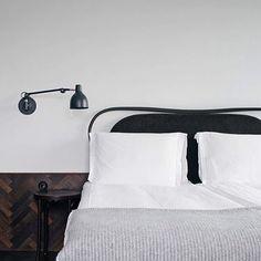 Black headboard and white linens. #interior #minimal #monochromatic // Instagram photo from pattyjdotcom | @leftyio