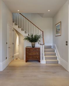 Beautiful soft tones of white, bone, honey and pale stone in this contemporary London home … especially love the kitchen with its wide-planked wood floors, striking marble island and counters, plus th Design Entrée, Flur Design, House Design, Interior Design, Interior Architecture, House Stairs, Carpet Stairs, Hallway Carpet, Style At Home