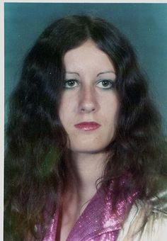 In the 1970s, women's hair was usually worn long with a centre parting.