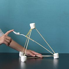 Keep the kids busy this summer constructing and playing with their own marshmallow catapults - made from supplies you have around the house.