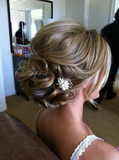 Loose updo with hair pin - good to use with veil