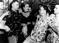 Hawaiian Shirt - It is a brightly colored shirt that has a nature print on it and originated from Hawaii. It combines a tropical fabric with a Western style. Pacific theater veterans returned home with these shirts and made them popular.