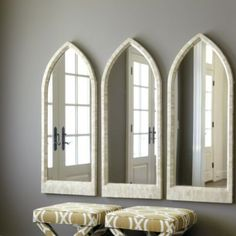 Love these, esp. the bone frame. Great in multiples across the sink wall. Bone Arched Mirror | Ballard Designs