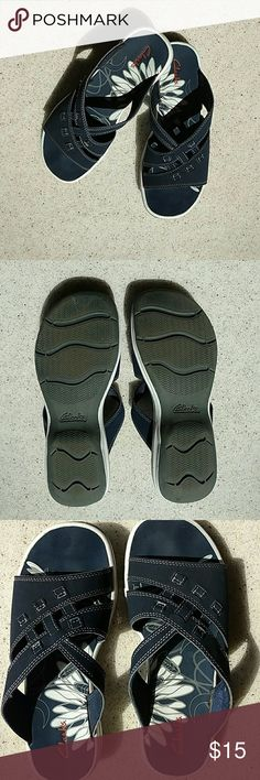Clarks Sandals, 7M, Shows no wear Worn inside of home. They show no wear on bottom of soles.  White on footbed and soles is still bright white.  Wearer had no toe fungus or athletes foot. Clarks Shoes Sandals