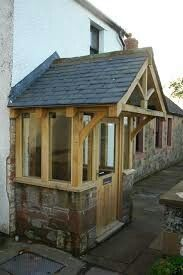 Enclosed front entry porch behind closed doors for Front porch roof kits