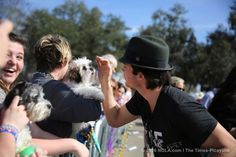 "Ian Somerhalder pets a dog during the Mardi Paws dog parade in Mandeville on Sunday (Feb. 14), 2016. Somerhalder, a Covington native and a graduate of St. Paul's School, is the founder of the Ian Somerhalder Foundation, which focuses on animal rights and environmental issues. Somerhalder, of ""Vampire Diaries"" fame, was a major draw for the parade. He and wife Reed, best known for her role as Rosalie Hale in the ""Twilight"" film series, were married in April 2015. The theme of this year's…"