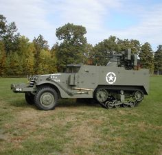 White Half Track, M-16, M3 with an anti- aircraft turret armed with 4 .50  caliber Browning heavy machine guns.