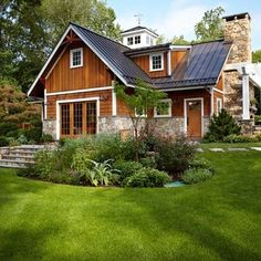 Fabulous.  Love the cedar with the white trim and stone.