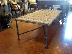 Recycled wood and metal table by Steel it Inc. you can see more of these incredible custom metal and custom metal with wood pieces @ steelitmetal.com