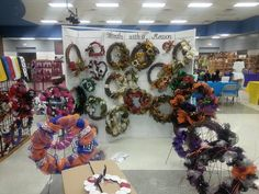 Wreaths with a Reason set up at craft show, wreath display