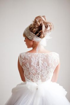 Head wrap by Shut The Front Door Bridal Accessories. Gown by Elizabeth De Varga.