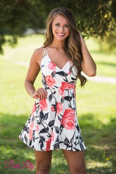 This dress is perfect for summer fun in the backyard or garden! Featuring a bold coral rose print with black and grey petals, this print really stands out in a crowd! We love the details this dress offers, as well.