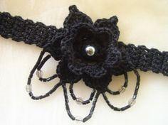 Crocheted flower choker with beads.