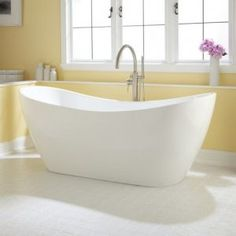 yellow bathroom interior with white soaking tub and arch faucet on white ceramic tiled floor. Elegant Stand Alone Bathtubs For Bathroom Interior Stand Alone Bathtubs, Stand Alone Tub, Bathtubs For Small Bathrooms, Yellow Bathrooms, Bathroom Tubs, Bathroom Ideas, Bathroom Stand, Bath Tubs, Cheap Bathtubs