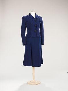 Schiaparelli wool suit with flag buttons 1937.  Owned by fashion icon Millicent Rogers.