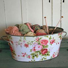 Mod podge fabric on any bucket. Very cute!
