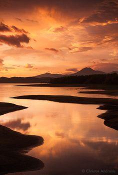 Fiery sunrise at Lake Plastira by Christos Andronis, via 500px