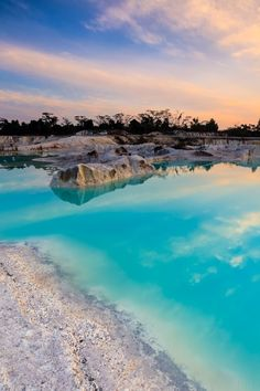 Turquoise Waters at sunrise at Danau Kaolin Lake on Pulau Belitung, Indonesia