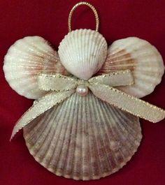 A little spray adhesive glitter, a little glue, a pretty bow and a faux pearl make a pretty pink seashell angel Christmas ornament.
