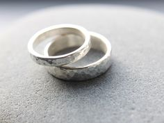 Hammered Wedding Ring Set In Argentium Silver, 5mm Men's Wedding Band & 3mm Women's Wedding Ring, Made To Order by OddPower on Etsy https://www.etsy.com/listing/193900365/hammered-wedding-ring-set-in-argentium