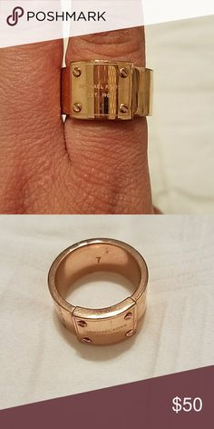 Michael Kors size 7 gold ring Michael Kors size 7 gold ring. Used some wear and tear. Make me an offer!! Michael Kors Jewelry Rings