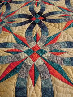 Close-up, Wedding Star by Tammy Zanella, based on Judy Niemeyer's Bali Wedding Star design; machine trapunto quilting