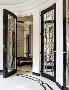 Art deco to ga ga over! In a Manhattan apartment designed by David Kleinberg, the entrance hall features ebonized-mahogany doors inset with mirror and silver-plate grillwork; the silver door hardware is by Nanz Interior Exterior, Home Interior Design, Floor Design, House Design, New York City Apartment, Manhattan Apartment, White Apartment, Apartment Entrance, Doors And Floors