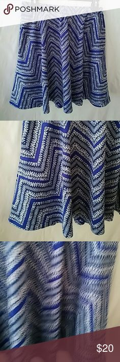 "Romeo & Juliet Vibrant Blue/White Print Skirt NWT Cute NWT Romeo & Juliet vibrant print skirt.  The skirt has an elastic waist.  Material: 95% polyester 5% spandex Approximate Measurements:  Waist 28""  Skirt Length 17.5"" Size: M Romeo & Juliet Couture Skirts"