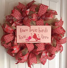 This Valentines Day wreath will make a cute addition to your valentines decor. Made with natural colored deco mesh and decorated with two