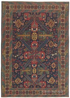 Caucasian Zejwa Kuba, 4ft 9in x 6ft 10in, Circa 1825. Among the rarest of Caucasian carpet subgroups, the best Zejwa antique carpets are avidly sought by mature tribal rug connoisseurs. This entirely singular example displays the distinctive Zejwa medallions with uncommon clarity and energy, its sophisticated latch hook and ray motifs expressing an expansiveness that immediately attracts attention.