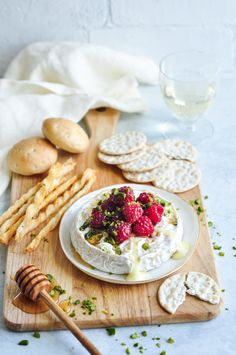Baked Camembert with Honey & Raspberries - the perfect addition to any cheese platter.