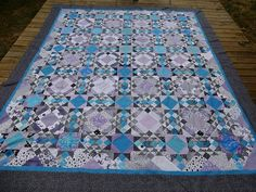 """Allietare in violet and blue by Vickie!  She says: ""It's done until I quilt it in the cooler weather. A little too large to be over my legs in this hot…"""
