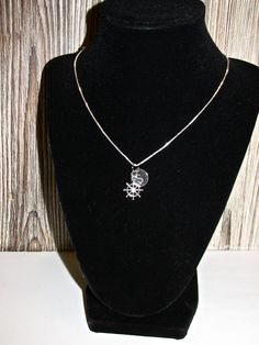 Sterling Sliver Disc Necklace and sail wheel charm, Initial Disc Necklace with sail wheel Charm, Personalized NECKLACE https://www.etsy.com/ca/listing/199455419/sterling-sliver-disc-necklace-and-sail?ref=shop_home_active_8