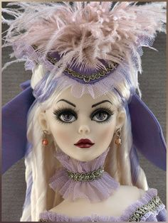 A Gathering Storm - Fall 2010 Exclusive   Wilde Imagination Vinyl Evangeline with inset violet eyes and applied lashes, platinum wigged hair with a violet streak. Designed exclusively for the 2010 Modern Doll Collectors Convention sold out dinner event ~ A Gathering Storm.  Sold Out   Debut Date:  Modern Doll Collectors Convention - Fall 2010