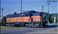 The Milwaukee found early, first-generation six-axle models from Alco useful in branch line work for their added tractive effort. Seen here ...