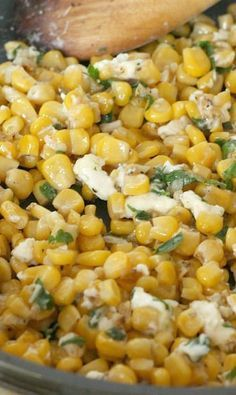 An easy yet interesting side dish to serve to guests - garlic butter sautéed corn with parsley and feta cheese! Ridiculously delicious.