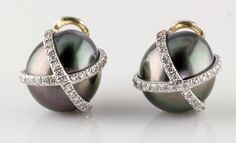 Verdura Black Pearl Gold Platinum Ear Clips   From a unique collection of vintage clip-on earrings at https://www.1stdibs.com/jewelry/earrings/clip-on-earrings/