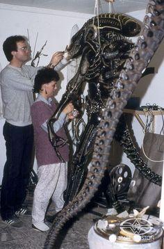 Richard Landon works on a hero alien xenomorph suit during the making of James Cameron's ALIENS.