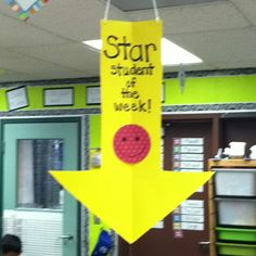Put this over student's desk for the week. I kind of like this idea- maybe on a smaller scale - hat?? something...