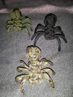 Paracord spiders. These would be fun for geocachers to find as swag, but I wonder how hard it would be to insert a plastic nano with a log sheet into one of these and turn it into a #geocache? :)