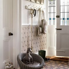We love the dog wallpaper and tiled floor in this hallway