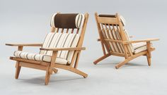 A pair of Hans J Wegner oak and fabric easy chairs, Getama, Gedsted, Denmark 1950's-60's. Marked GETAMA GEDSTED DENMARK, DESIGN HANS J WEGNER.