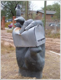 Art that is a bit weird, a bit unusual, and a bit twisted. Makes you wonder if that's what will happen to the mailman if he puts bills in the box. - - - - - Unusual mailbox<<Is satan holding my mailbox for me? Funny Mailboxes, Unique Mailboxes, Custom Mailboxes, 3d Street Art, Statues, Creepy Hand, Art Postal, Talk To The Hand, Beton Design