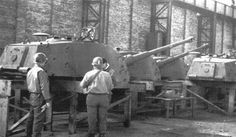 US soldiers inspect a row of turrets made for German heavy tanks 'Royal Tiger' at 'Henschel' factory.