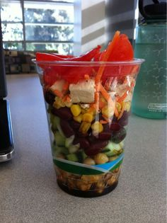 A satisfying, complex carb, fiber filled, and protein packed Veggie Parfait! Beautiful as it is healthy!  ...Chickpeas, cucumbers, kidney beans, corn, carrots, tofu, tomatoes, balsamic vinegar.... Perfect for the teacher's 23 minute 'lunch' (more like snack to get you through 'till final bell!!)