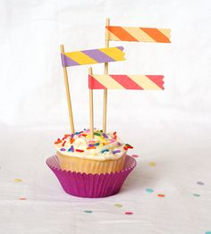Simple way to make a cupcake look Grand!  Cupcake toppers like this mean you don't need a lot of frosting on the cupcake.